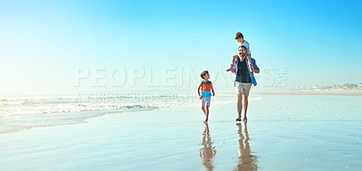 Buy stock photo Shot of a father and his two little sons enjoying some quality time together at the beach
