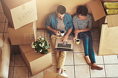 Buy stock photo Shot of young people packing up on moving day