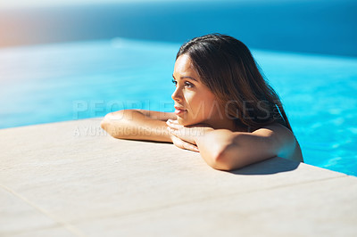 Buy stock photo Shot of an attractive young woman spending some time in the pool