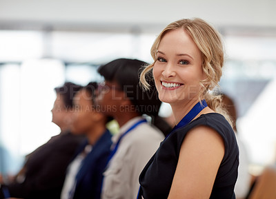 Buy stock photo Portrait of a happy and confident young businesswoman attending a business conference