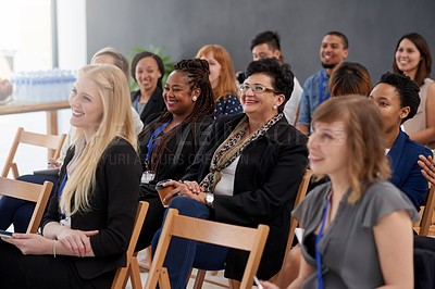 Buy stock photo Shot of an audience of businesspeople enjoying a conference