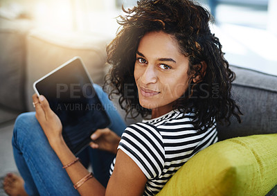 Buy stock photo Shot of an attractive young woman relaxing at home on the weekend