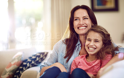 Buy stock photo Shot of a beautiful mother and her adorable daughter bonding at home