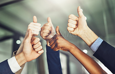 Buy stock photo Cropped shot of a group of businesspeople showing a thumbs up gesture