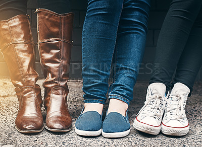 Buy stock photo Cropped shot of a group of unrecognizable people standing together