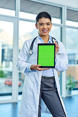 Buy stock photo Portrait of a young female doctor holding a digital tablet with a chroma key screen