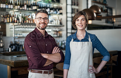 Buy stock photo Cropped portrait of two businesspeople standing proudly in their coffee shop