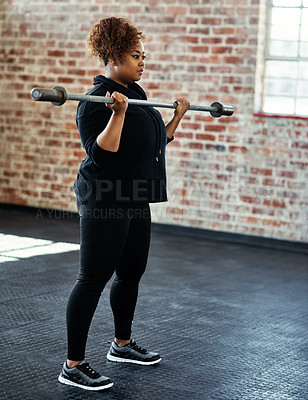 Buy stock photo Shot of a young woman working out in a gym