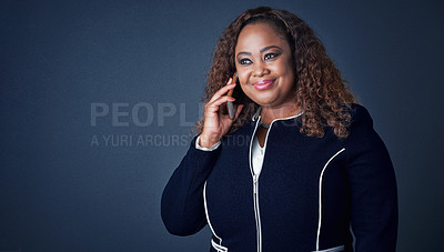 Buy stock photo Studio shot of a cheerful young businesswoman talking on the phone to a client while looking in a certain direction