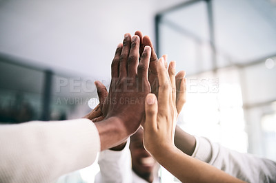 Buy stock photo Shot of a motivated group of unrecognizable businesspeople's hands coming together for a high five