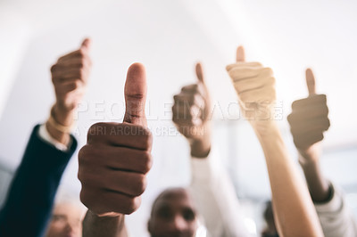 Buy stock photo Shot of a motivated group of unrecognizable businesspeople raising their hands and showing thumbs up