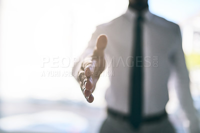 Buy stock photo Shot of a unrecognizable business person stretching out their hand for a handshake