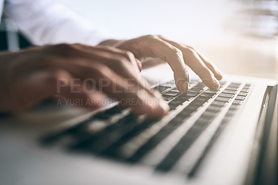 Buy stock photo Closeup shot of a unrecognizable business person typing on a laptop keyboard