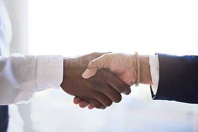 Buy stock photo Shot of two unrecognizable businesspeople shaking hands in agreement