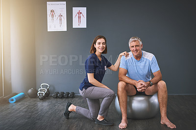 Buy stock photo Full length portrait of a female physician working with a senior male patient