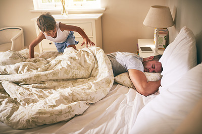 Buy stock photo Shot of a little boy waking up his father from bed in the morning