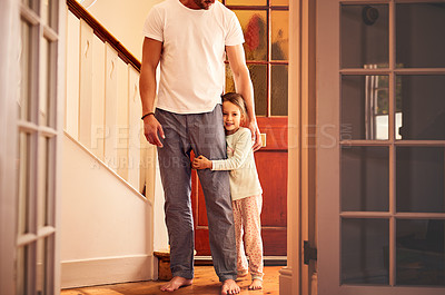 Buy stock photo Portrait of a cheerful little girl playing around the house with her dad while she looks at the camera at home
