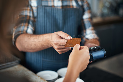 Buy stock photo Closeup shot of a unrecognizable person giving a barman a credit card as payment inside of a restaurant