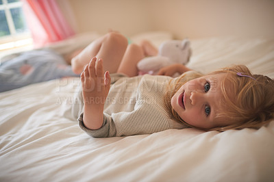 Buy stock photo Portrait of an adorable little girl relaxing on the bed at home