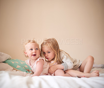Buy stock photo Shot of two adorable sisters bonding together at home