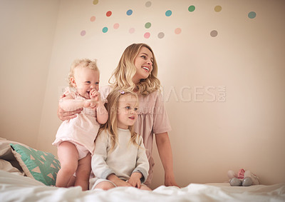 Buy stock photo Shot of an adorable family of three bonding together at home