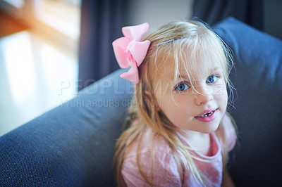 Buy stock photo High angle portrait of an adorable little girl sitting on the sofa at home