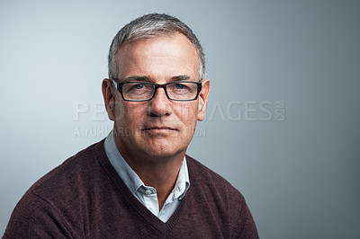 Buy stock photo Studio shot of a handsome mature man against a grey background