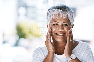 Buy stock photo Portrait of a cheerful mature woman holding her face with her hands while looking at the camera