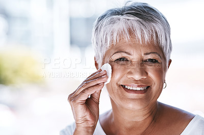 Buy stock photo Shot of a mature woman going through her beauty routine at home