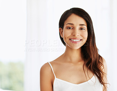 Buy stock photo Portrait of a happy and beautiful young woman indoors