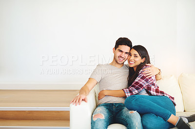 Buy stock photo Shot of a young attractive couple at home
