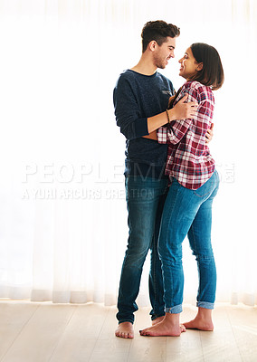 Buy stock photo Full length shot of an affectionate young couple embracing in their home