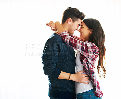 Buy stock photo Cropped shot of an affectionate young couple embracing in their home