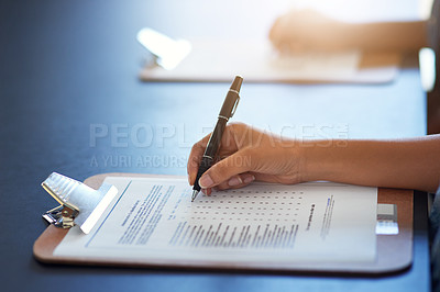 Buy stock photo Cropped shot of an unrecognizable businesswoman filling in a questionnaire
