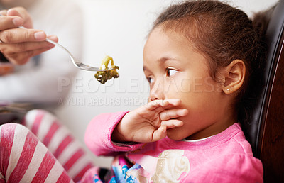 Buy stock photo Shot of a little girl refusing to eat her food
