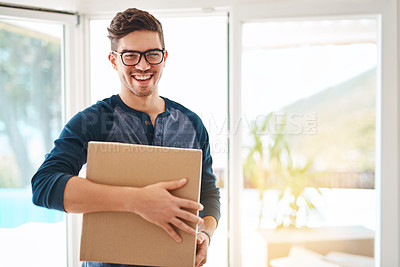 Buy stock photo Shot of a happy young man on moving day