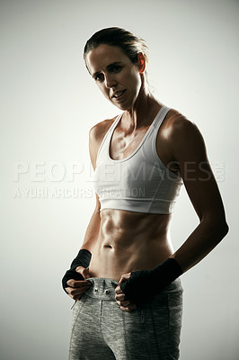 Buy stock photo Studio portrait of an athletic young sportswoman posing against a grey background