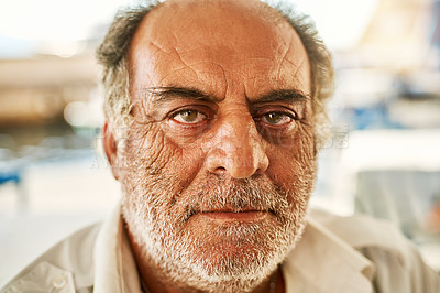 Buy stock photo Portrait of a confident senior man standing outside while looking at the camera