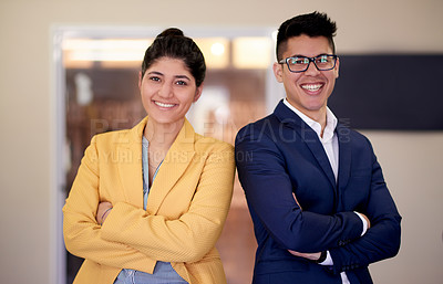 Buy stock photo Portrait of two confident young businesspeople standing in an office