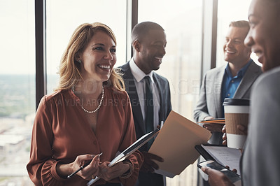 Buy stock photo Cropped shot of a group of corporate businesspeople meeting in their boardroom