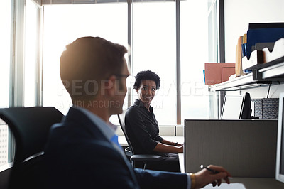Buy stock photo Cropped shot of two businesspeople taking in an office