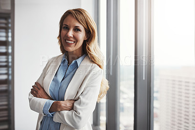 Buy stock photo Portrait of a professional businesswoman standing in an office