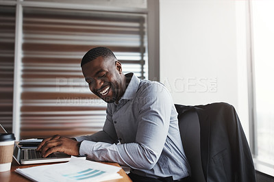 Buy stock photo Cropped shot of a handsome businessman laughing while working in his corporate office