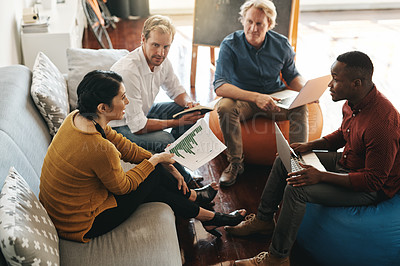 Buy stock photo Shot of a diverse group of designers brainstorming together in an office