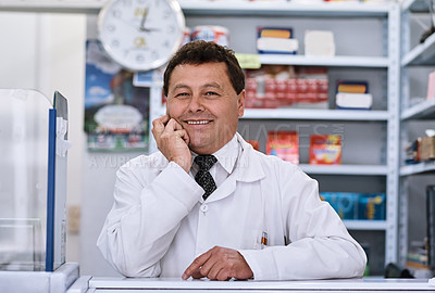 Buy stock photo Portrait of a male pharmacist in a pharmacy