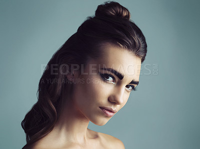 Buy stock photo Studio shot of an attractive young woman wearing artistic makeup