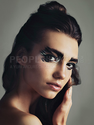 Buy stock photo Studio shot of an attractive young woman wearing bold eye makeup