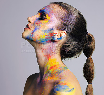 Buy stock photo Studio shot of an attractive young woman with brightly colored makeup against a purple background