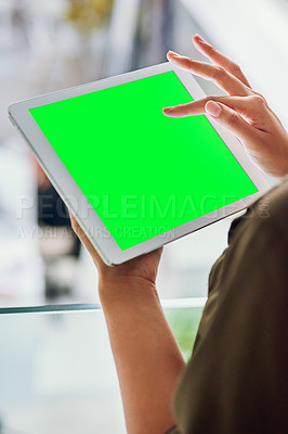 Buy stock photo Shot of an unrecognizable businesswoman using a tablet at the office