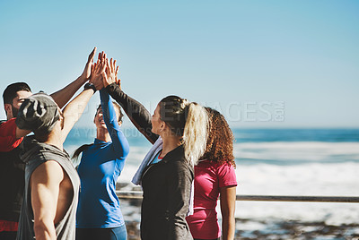 Buy stock photo Cropped shot of a fitness group high-fiving before a run